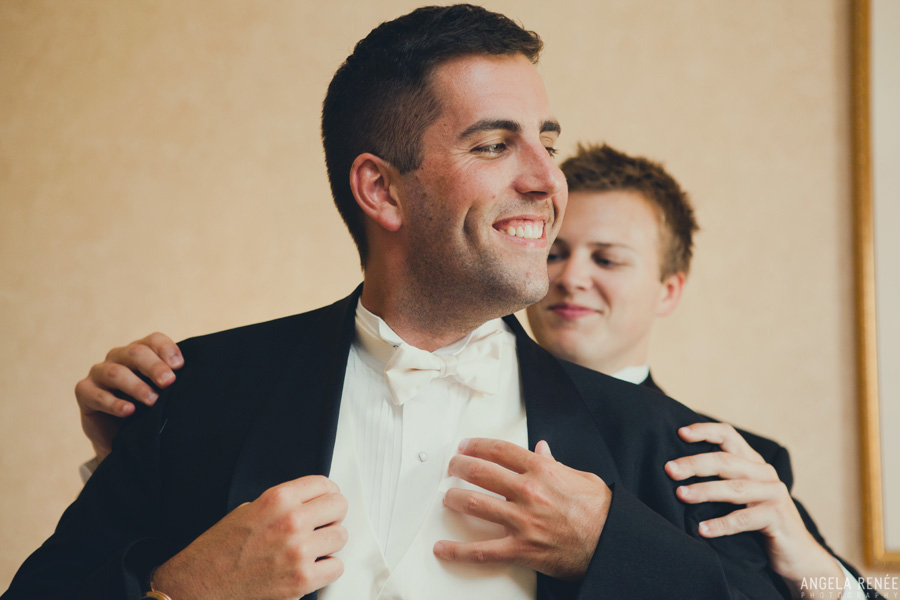groom-putting-on-jacket