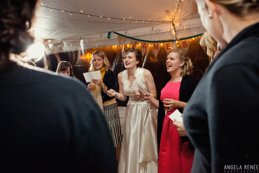 bride singing at vintage backyard wedding reception