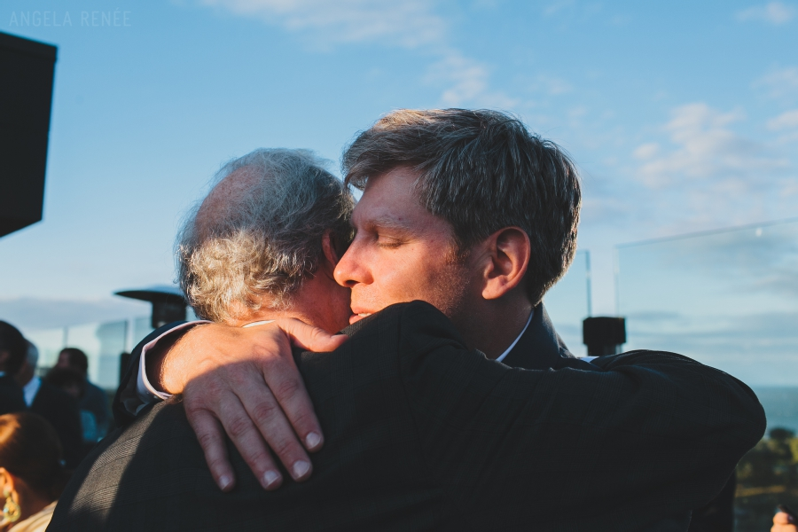 groom hugging his brother