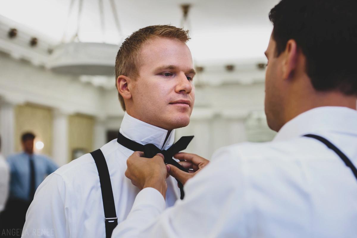 groom-putting-tie-on
