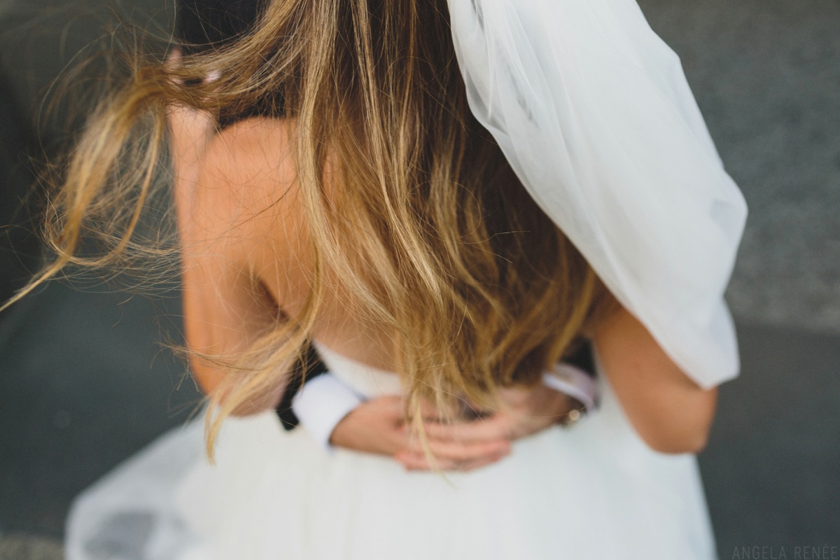 artistic wedding day photo of brides hair