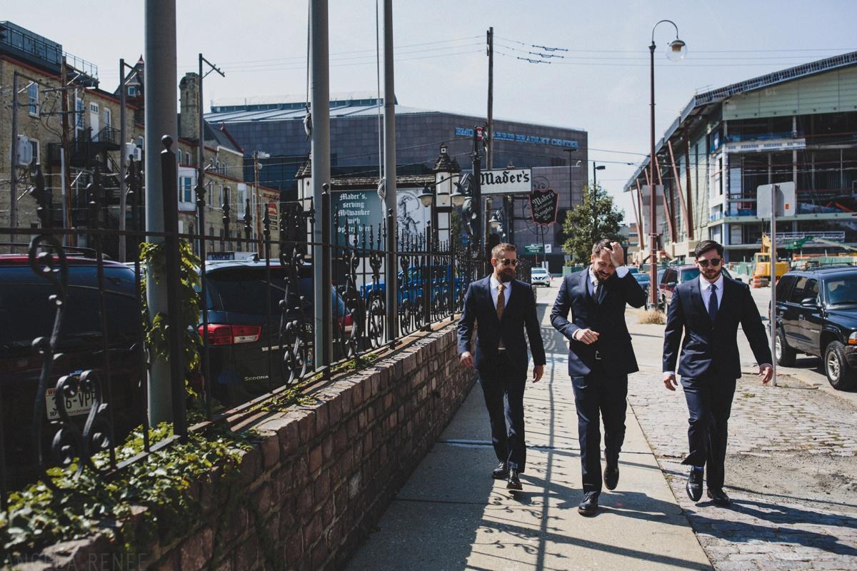 groom walking to first look