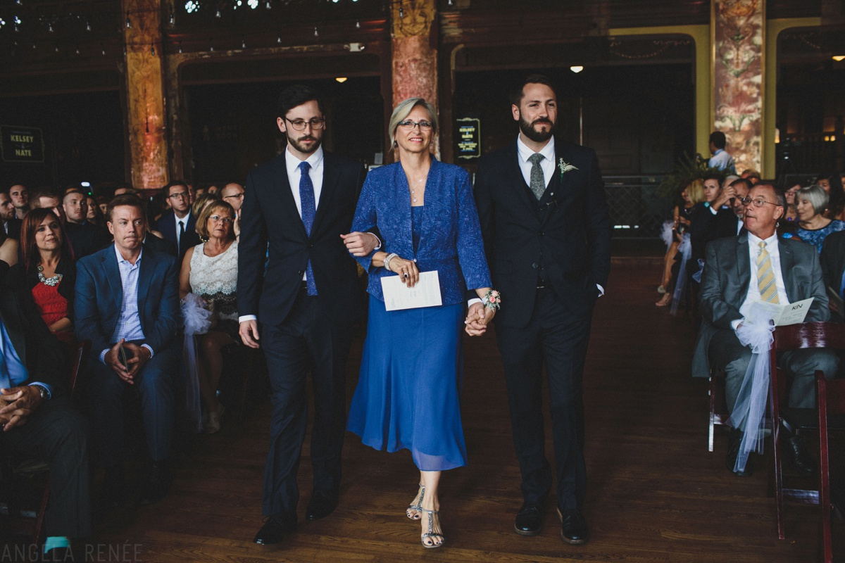 groom walks mom up aisle