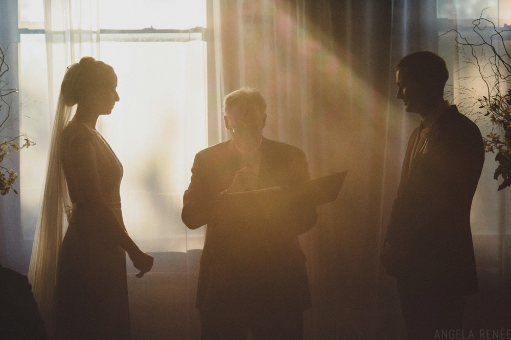 backlit-windows-wedding-ceremony