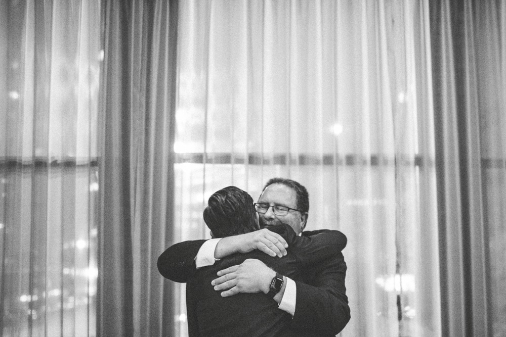 dad-hugging-groom